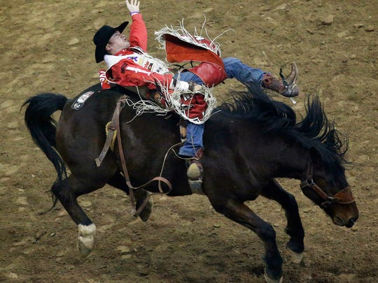 Steven Peebles competes in the bareback riding event for a first place score of 89.5 during the eighth go-round of the National Finals Rodeo, Thursday, Dec. 10, 2015, in Las Vegas.