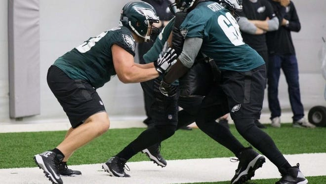Eagles rookie Isaac Seumalo, left, works on a blocking drill during a recent practice. He has moved into a starting role at left guard.