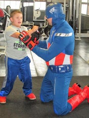 Landon Crawford, 9, learns a self defense move from