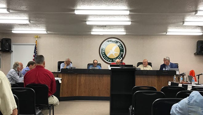 St. Lucie West Services District Board of Supervisors discuss the potential purchase of St. Lucie Trail Golf Club. The bid was turned down Tuesday, June 6, 2017.