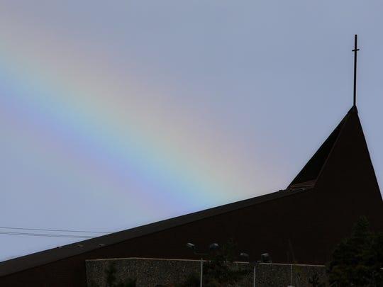 A rainbow is seen Wednesday near Madonna del Sasso Catholic Church in Salinas.