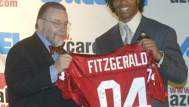 Cardinals owner Bill Bidwill, left, presents Larry Fitzgerald, (cq) the first round draft pick for the Cardinals.