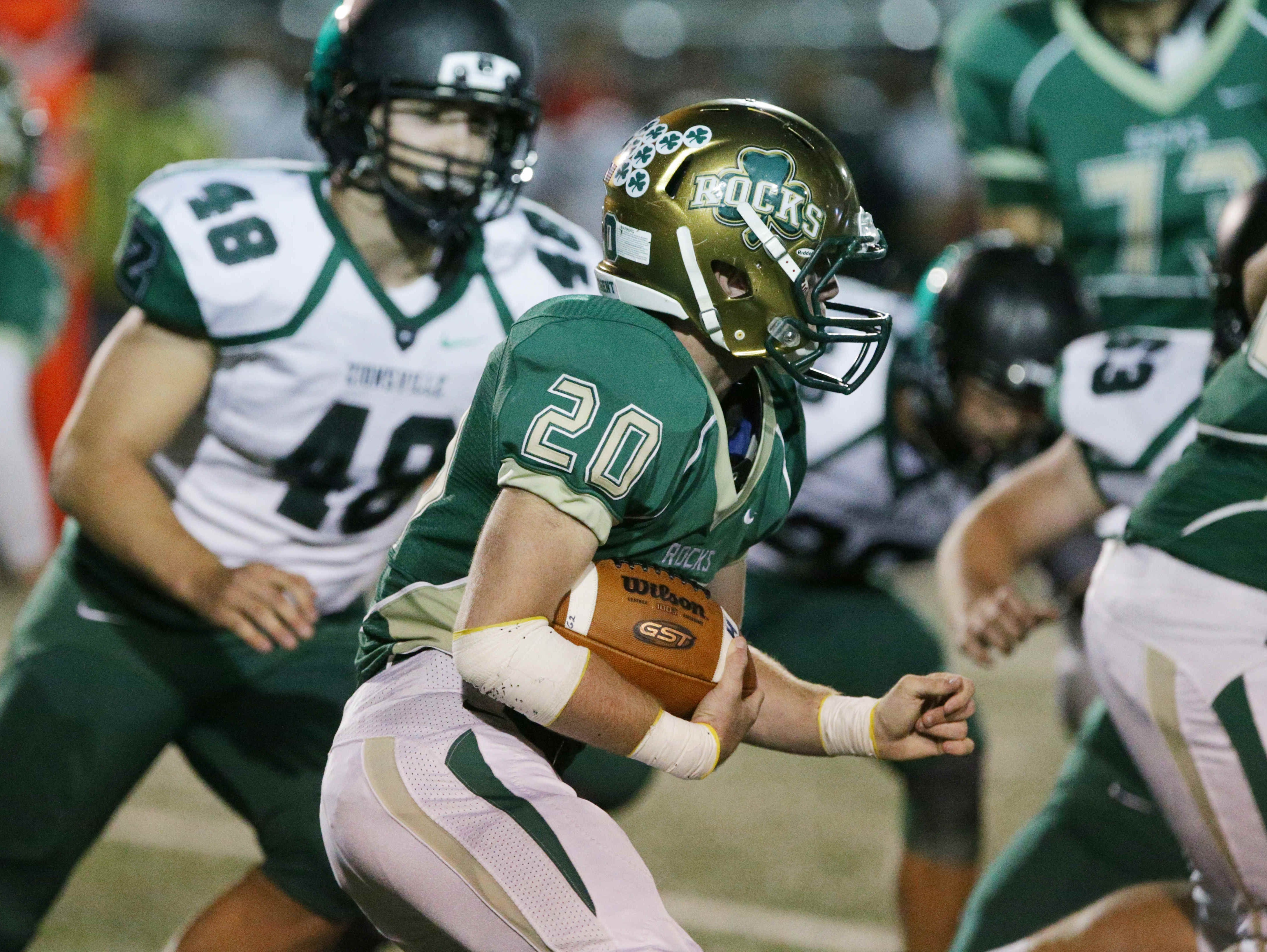 Westfield's No. 20, Owen McGraw looks for a hole in Zionsville's defense, Friday September 2nd, 2016. Westfield faced off against Zionsville at Westfield's Riverview Health Stadium.