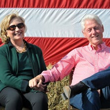 Former President Bill Clinton and his wife former Secretary of State Hillary Rodham Clinton attend the 37th Harkin Steak Fry, September 14, 2014 in Indianola, Iowa.