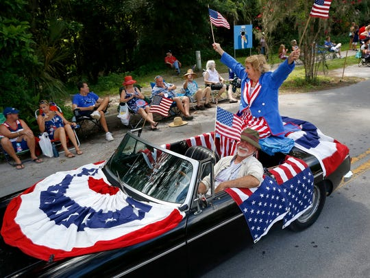 """Decked out in full American flag decor this """"float"""" makes its way down Tuscawilla Road during the annual Fourth of July Parade, in Micanopy, Fla. on July 4, 2017."""
