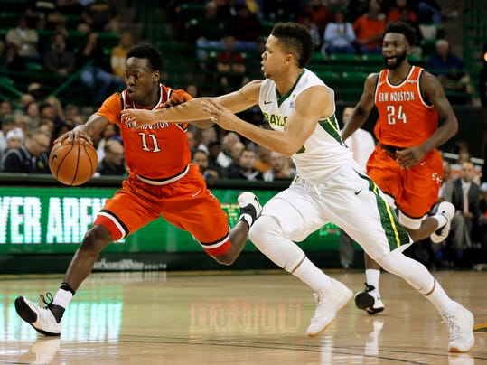 Sam Houston State's John Dewey III (11) out sprints Baylor's Manu Lecomte of Belgium, right, as Dewey reaches a loose ball in the first half of an NCAA college basketball game, Wednesday, Nov. 30, 2016, in Waco, Texas. (AP Photo/Tony Gutierrez)
