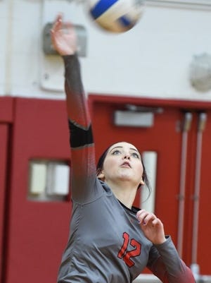 Senior Josie VanDyke is one of Clarenceville's leading servers and hitters.