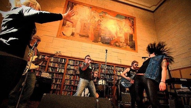 The GunG-Hoes, shown here rocking out at the Green Bay West High School library, will play Gasoline on Green Bay's Broadway on Friday night.