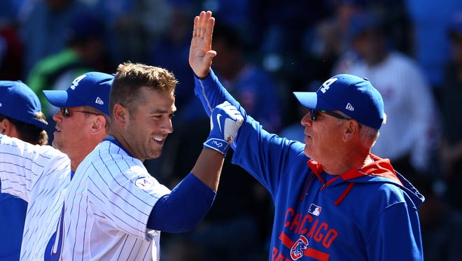 Cubs manager Joe Maddon, here celebrating with Mike Olt, is facing big expectations in his first season.