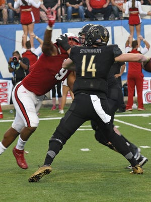 Vanderbilt's Kyle Shurmur is pressured by North Carolina State's Bradley Chubb at the Camping World Independence Bowl.