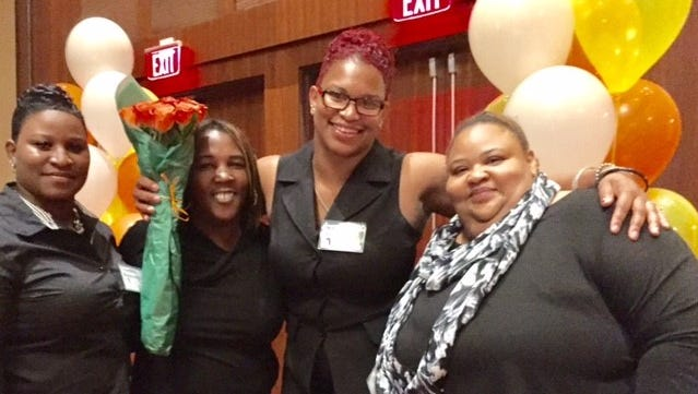 With family at her side, Nikki Vandergriff (at center) celebrates her Independence Award from Easterseals. Pictured are (from left) Independent Provider Courtney Meatchem, Vandergriff's cousin Jerilyn Lewis, Vandergriff, and her aunt LaTanya Jefferson.