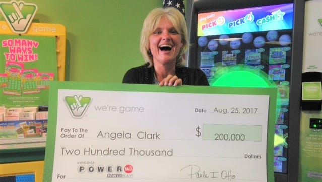 Angela Clark with her $200,000 winnings from the Powerball.