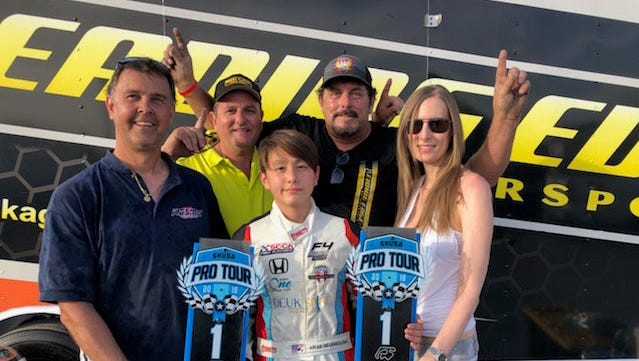 Arias Deukmedjian with his Leading Edge Motorsports Team shown with back-to-back trophy wins in the x30 junior class at Superkarts! SKUSA Spring Nationals event.