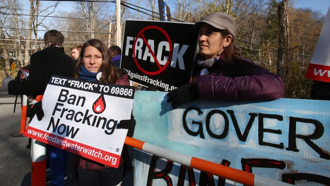 Anti-fracking protesters wait for Gov. Andrew Cuomo to arrive to vote at the Presbyterian Church of Mount Kisco on Nov. 4. As New York continues to study whether to allow hydraulic fracturing in New York, demonstrators pop up at various gubernatorial appearances.