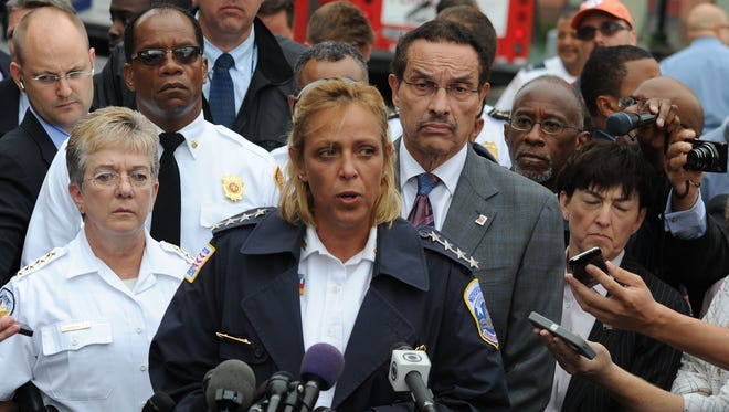 D.C. Police Chief Cathy Lanier, with Mayor Vincent Gray behind, speaks about the shootings at Washington Navy Yard on Monday.