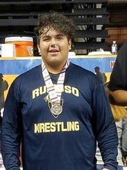 Freshman wrestler Mikey Marin celebrates a second place