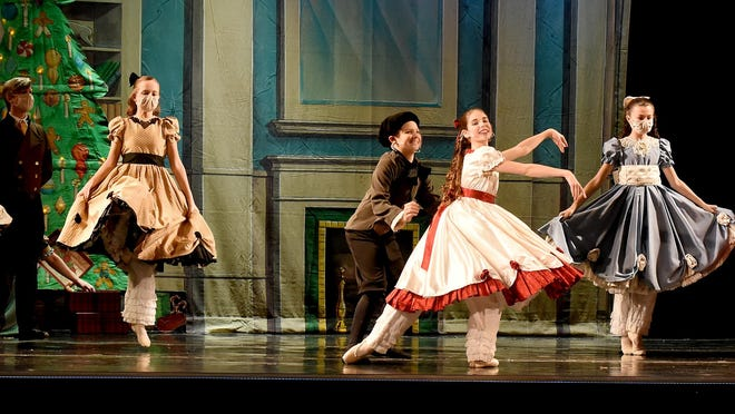 """Jessica Foulkrod as an icicle (from left), Stormy Davis as the Ice Princess, Erika Bressler as an icicle and Liesl Kraft as Clara dance in """"The Nutcracker Ballet"""" snow scene."""