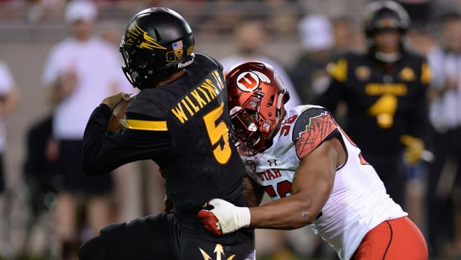 Utah defensive end Pita Taumoepenu (50) sacks Arizona State quarterback Manny Wilkins (5) during the first half.