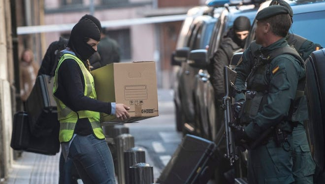 Members of the Spanish civil guard remove items on Feb. 14 from the home of an Algerian national arrested in relation to jihadist links in Bilbao, Spain.