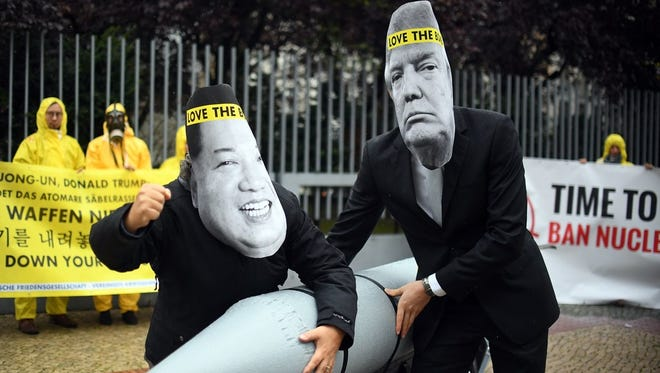 Picture taken on Sept. 13, 2017, shows activists of the International Campaign to Abolish Nuclear Weapons (ICAN) wearing masks of President Trump, right, and North Korea's leader Kim Jong Un.
