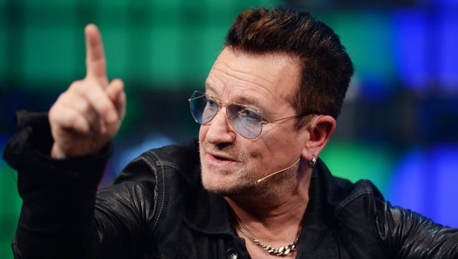 U2 singer Bono talks on stage at the Web Summit in Dublin on Nov. 6.