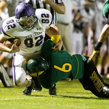 Show Low's Garrett Means (seen here tacking Queen Creek's Hunter Redd) is part of the core group of players returning for coach Randy Ricedorff. Show Low enters the season as Division IV's No. 1-ranked team.