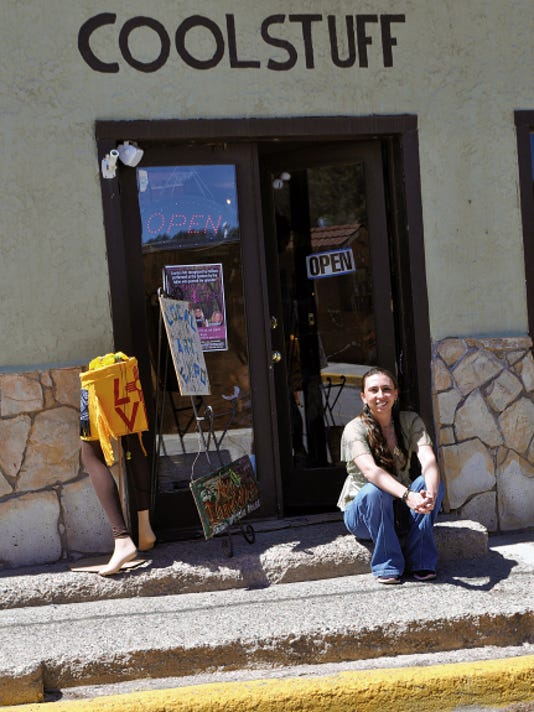 Kendra King sits in front of her shop at 102 Center Street where she houses an eclectic collection of funky local and not so local cool stuff.