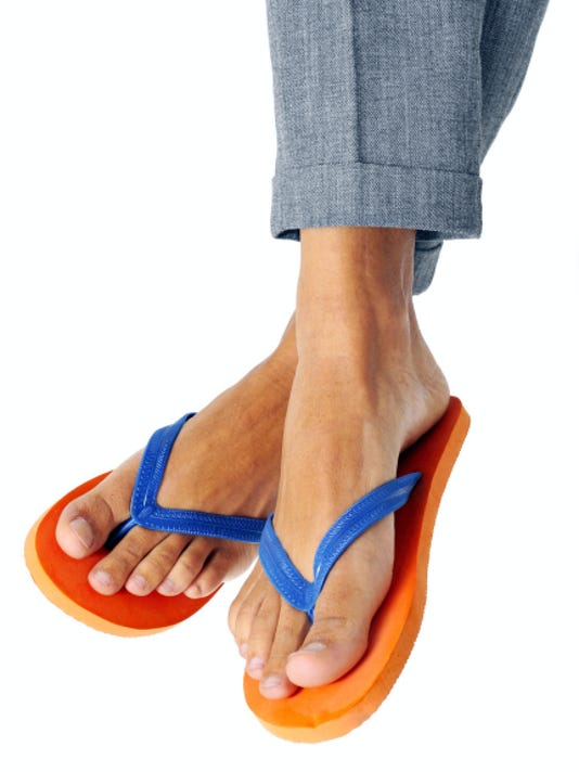 Even though it's hot outside during the summer, employees should avoid flip flops and T-shirts in the office.