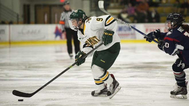 Vermont's Dayna Colang (9) skates with the puck during the women's hockey game between the UConn Huskies and the Vermont Catamounts at Gutterson Fieldhouse earlier this season.