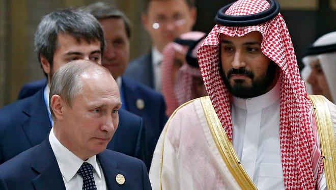 Russian President Vladimir Putin (L) meets with Saudi Arabia's Deputy Crown Prince Mohammed bin Salman (R) during the G20 Summit in Hangzhou, China, on Sept. 4, 2016.