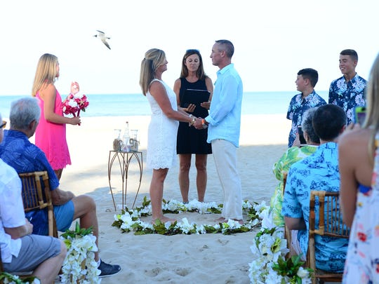 Terry and Lori Wolfsheimer got married on the beach