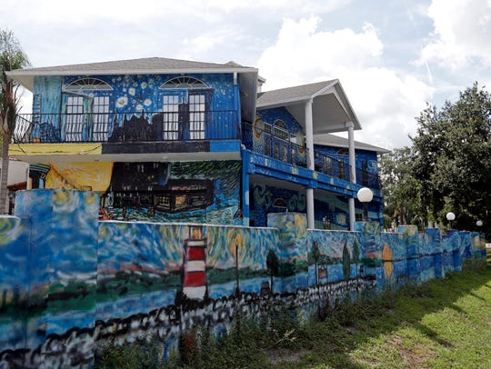 This Wednesday, July 18, 2018 photo shows the painted exterior of the home of Lubomir Jastrzebski and Nancy Nemhauser in Mount Dora, Fla.