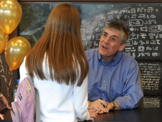 Best-selling author Rick Riordan meets a young fan
