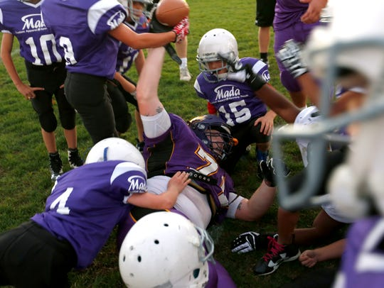 Summer college football camps have grown to include national elite camps to Division I and II camps and schools in the Wisconsin Intercollegiate Athletic Conference such as UW-Stevens Point woth with area youth football players.