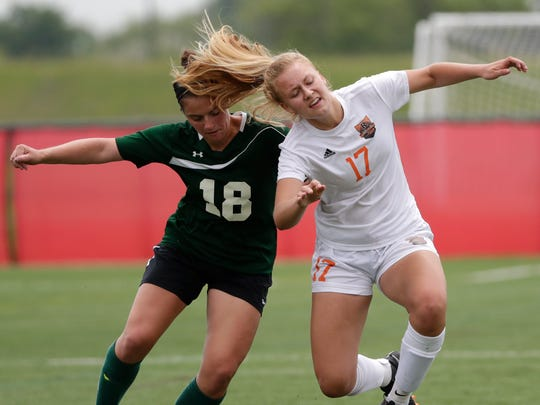 Cedar Grove-Belgium High School's Abby Kraus (17) is fouled by Heights/Barneveld High School's Samantha Bollig (18) during their WIAA Division 4 Semifinal girls state soccer game Friday, June 15, 2018, at Uihlein Soccer Park in Milwaukee, Wis.