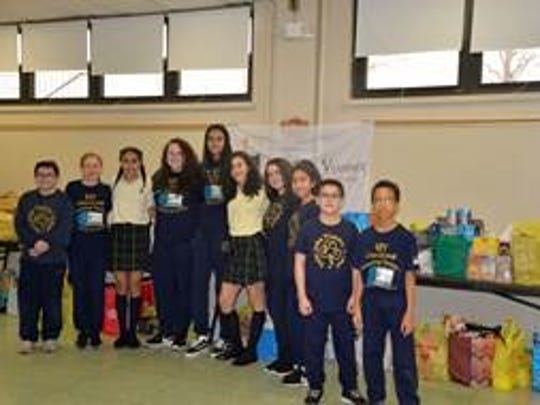 St. John Vianney School students support the Woodbridge Have-A-Heart Food Drive.