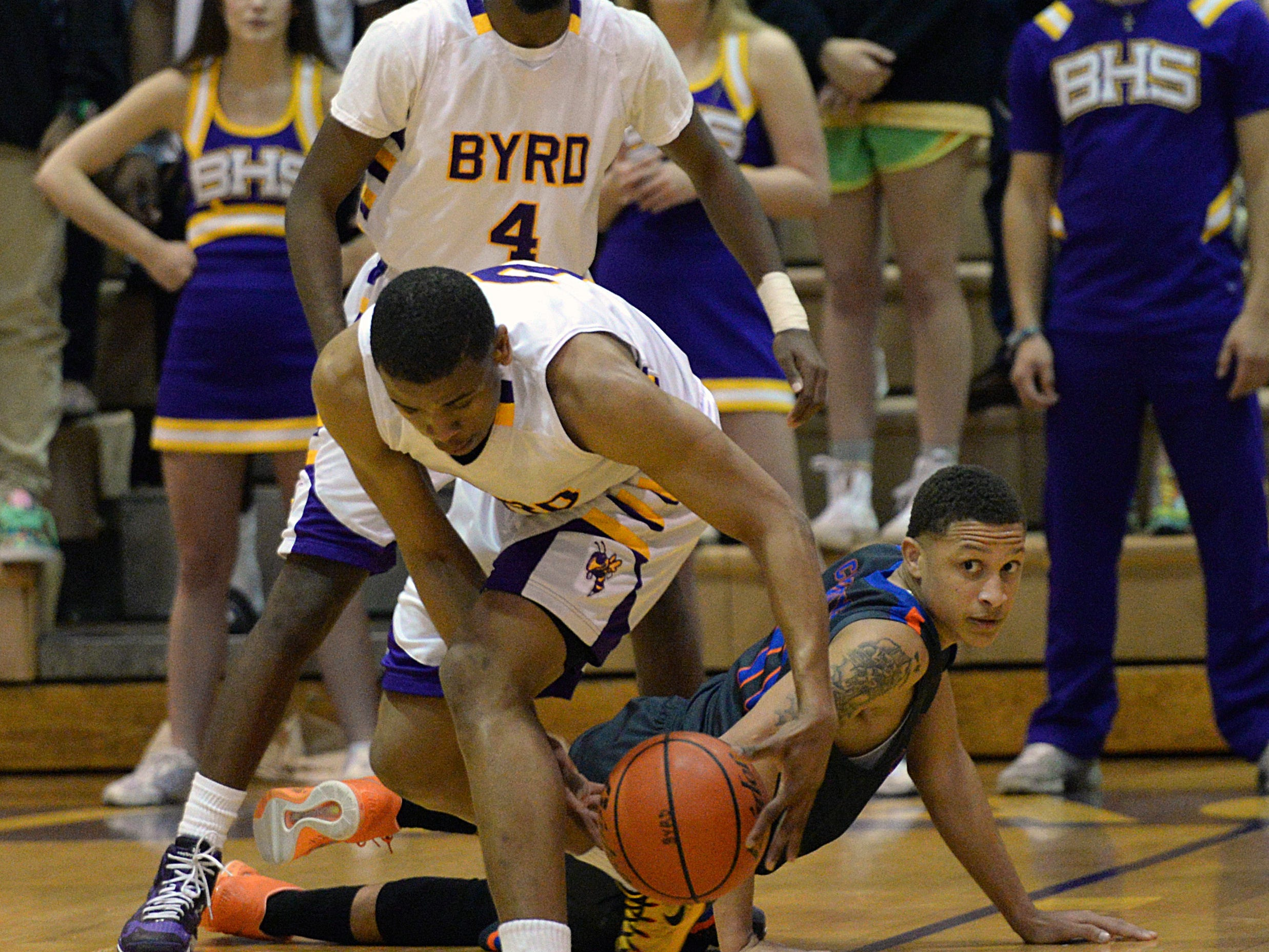 Byrd's Chad Lott steals the ball away from Southwood's Terion Bell in an 82-75 win.