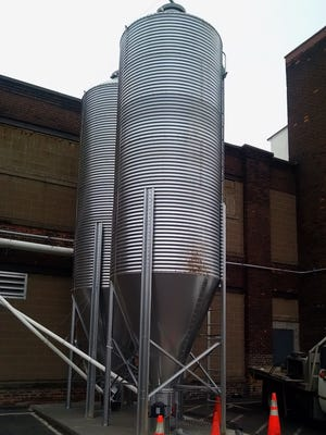 Because of increased demand, Black Button Distilling has installed two 15-ton grain silos outside the distillery at 85 Railroad St.