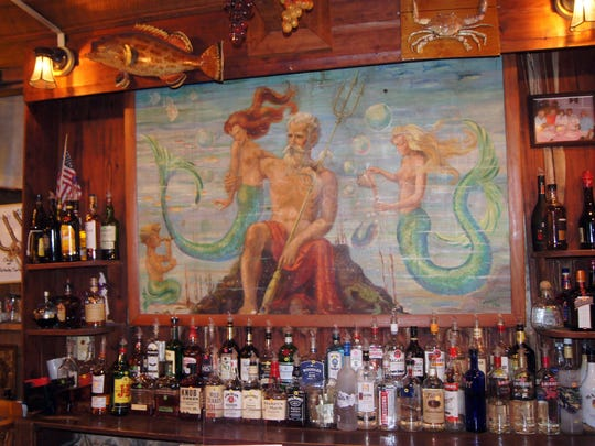 One of hotel hallmarks is the tavern located downstairs across from the front desk. A painting of King Neptune sits over the bar, and wall paintings drawn by a 1947 visitor, Helen Tooker, who in exchange for room and board, painted scenes of Cedar Key, adorn the hotel. Locals insist the best meal on the island is the Island Hotel.