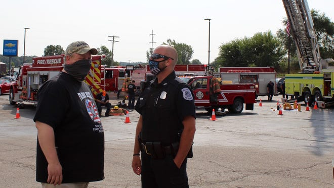 """Frank Beck Chevrolet General Manager Garin """"Buck"""" Ellis talks with Chad Smith with the Hillsdale City Police during the Salute to First Responders Saturday."""