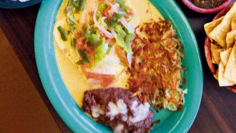 Huevos Rancheros topped with delicious green chile and a mouth-watering cheese sauce, as well as the hearty Menudo with all the fixings, are the crowd favorites at Cuauhtemoc Cafe, 6840 Montana.