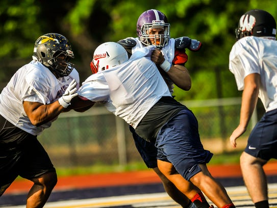Dunellen's Alain Diaz works with other offensive linemen