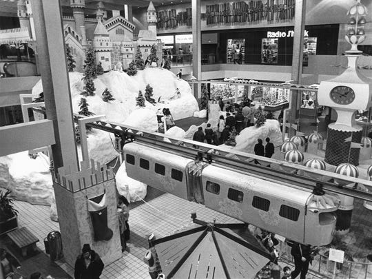 Christmas in Midtown Plaza featured Magic Mountain, Santa Claus and the monorail during the holidays for many years. Christmas in Midtown Plaza, shown here in 1977, featured Magic Mountain, Santa Clause and the monorail during the holidays for many years.