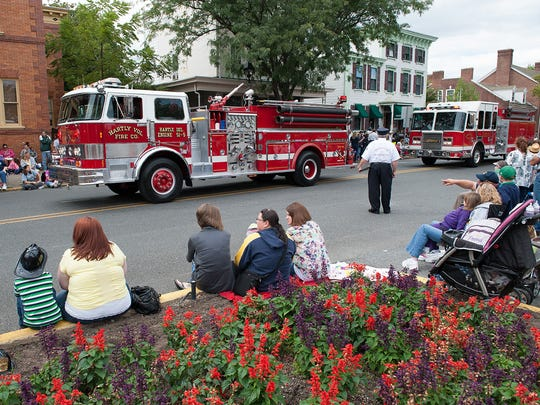The Hartly Volunteer Fire Co. moves past onlookers lining State Street during an annual DVFA volunteer firefighter parade in Dover.