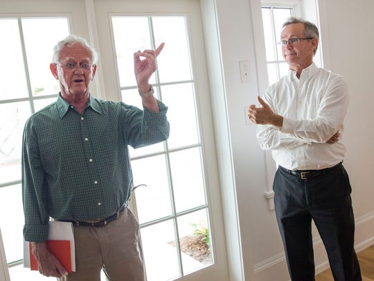 Raymond Miller, left, and his son, Stuart, recall the history of the Immokalee Cottage, built on 11th Avenue South in 1920. The Millers acquired the property in 1975, and have been a part of the renovation project.