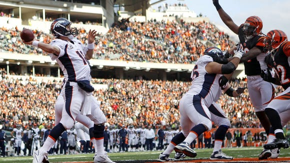 Peyton Manning throws out of the PBS end zone in 2012.