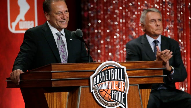 Basketball Hall of Fame inductee Tom Izzo, left, speaks as presenter Gary Williams listens during induction ceremonies at Symphony Hall, Friday, Sept. 9, 2016, in Springfield, Mass. (AP Photo/Elise Amendola)