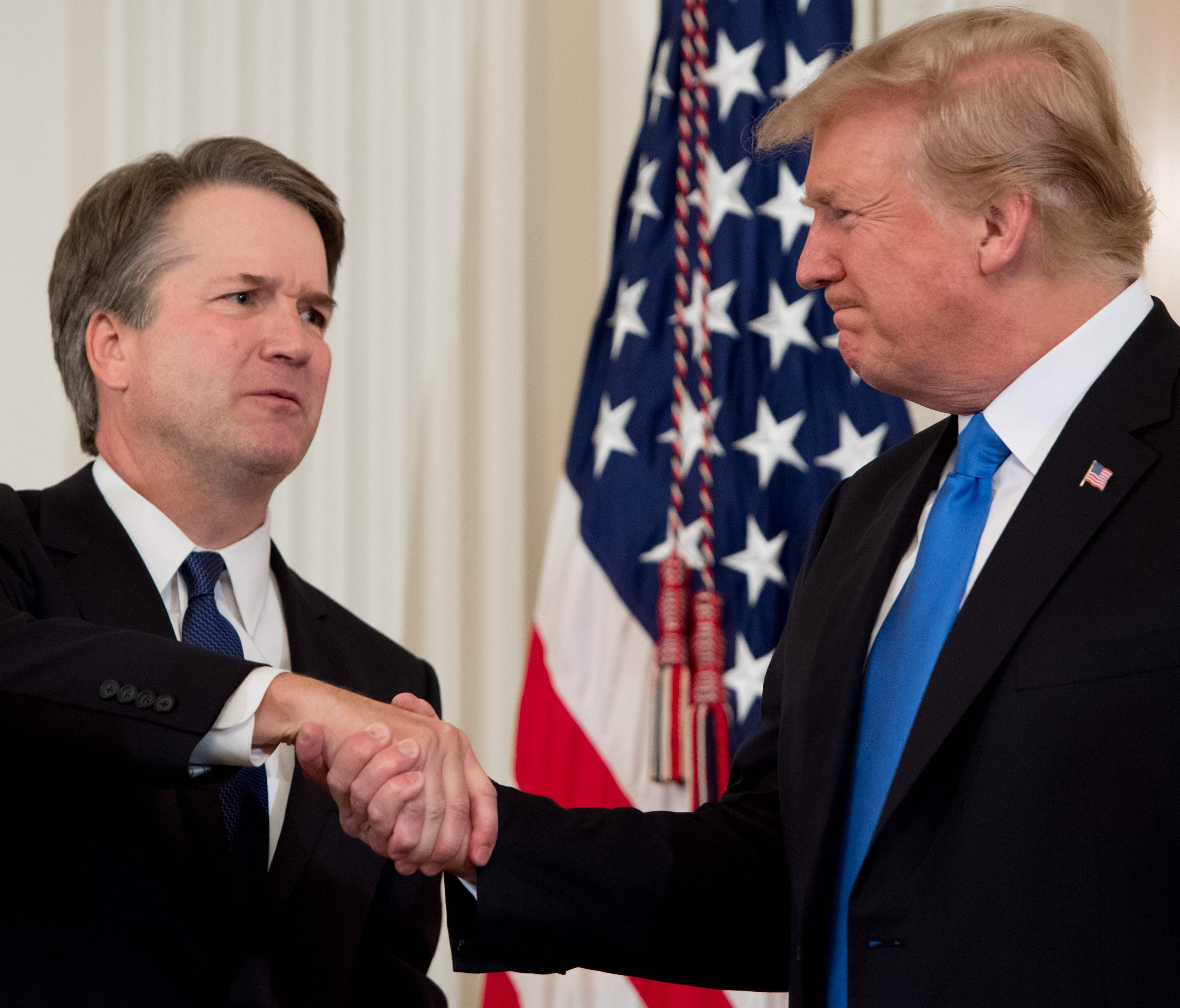 Judge Brett Kavanaugh shakes hands with President Donald Trump after being nominated to the Supreme Court in the East Room of the White House on July 9, 2018 in Washington, D.C.