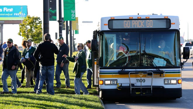 A Green Bay Metro Transit bus drops off fans along Lombardi Avenue before the Green Bay Packers game against the New York Giants at Lambeau Field.