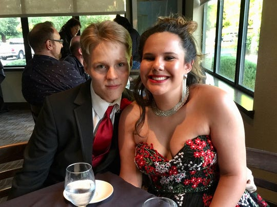 Domynic Gaither, left, and Shi Trine at the Woodside Grill on prom night.